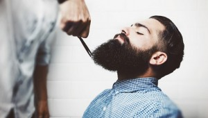 Bearded hipster in a barber shop